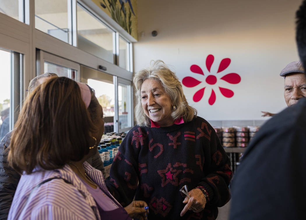 Rep. Dina Titus, D-Nev., greets LaSonia Dixon, 77, of North Las Vegas as they wait in line to c ...