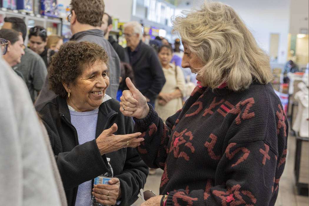 Guadalupe Cantu, 83, of Las Vegas, left, speaks with Rep. Dina Titus, D-Nev., as they wait in l ...