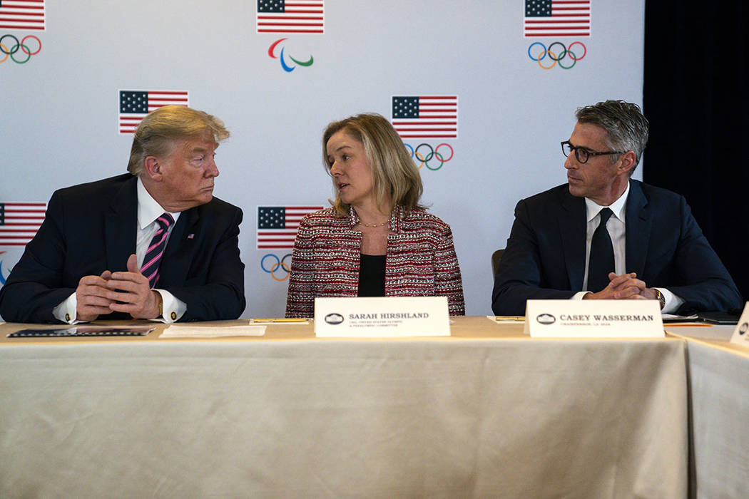 President Donald Trump, left, and LA 2028 Committee Chairman Casey Wasserman, right, listen as ...