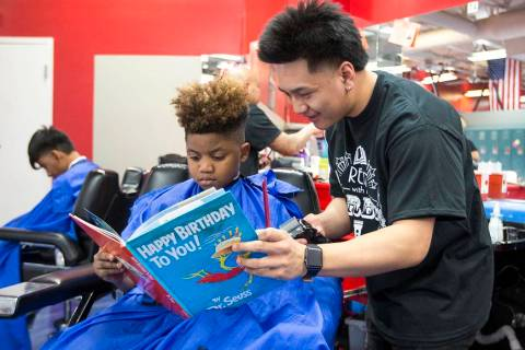 """Barber student Tristian de Guzman reads to Nicholas Lewis, 12, during the third annual """"Re ..."""