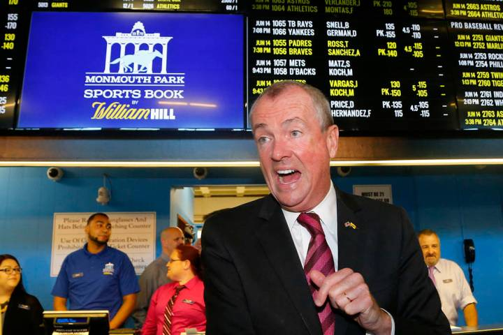 New Jersey Governor Phil Murphy, arrivers to make the first wager with Monmouth Park Sports Boo ...