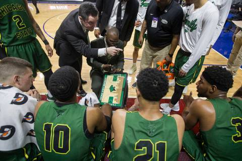 Chicago State gets coached up during a timeout in the second half during the Cougars opening ro ...