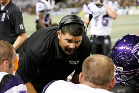 Weber State defensive line coach Chad Kauha'aha'a talks to his players as they play Hawaii in a ...