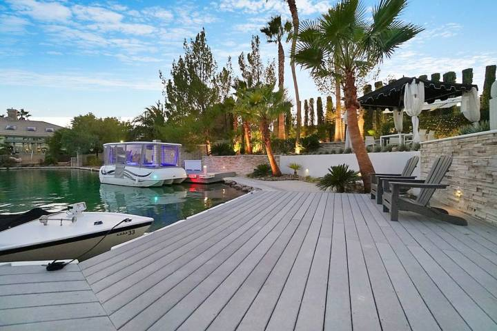 This mansion in the Lakes community at 2909 Coast Line Court comes with its own dock and boat. ...