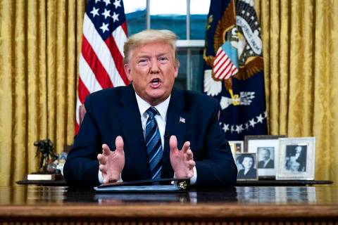 President Donald Trump speaks in an address to the nation from the Oval Office at the White Hou ...