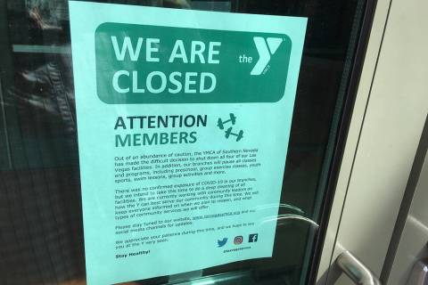 A notice posted on the door of the Centennial YMCA tells patrons about the building's closure. ...
