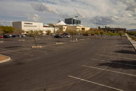 One of the near empty parking lots at Downtown Summerlin which has modified hours and some busi ...