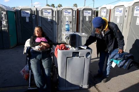 """Erica """"E.Z."""" Zehm, 42, at hand washing stations at The Courtyard Homeless Resource Ce ..."""