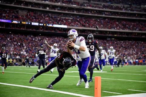 FILE - In this Jan. 4, 2020, file photo, Buffalo Bills quarterback Josh Allen (17) catches a pa ...