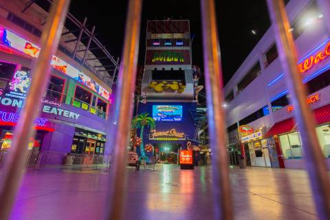 Gates block the entrance to the Fremont Street Experience in downtown Las Vegas, which is close ...