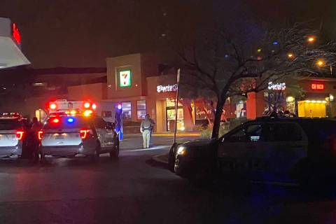 Las Vegas police officers investigate what was reported as a robbery at a convenience store on ...