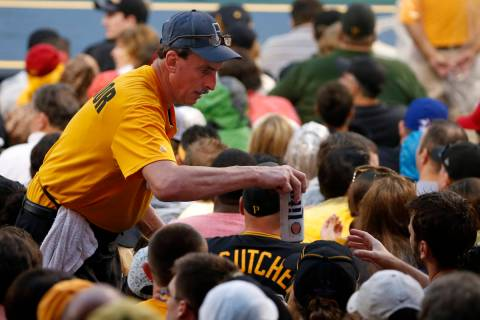 A PNC Park beer vendor serves a beer during a baseball game between the Pittsburgh Pirates and ...