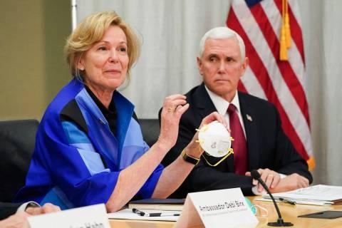 Dr. Deborah Birx, Ambassador and White House Coronavirus response coordinator holds a 3M N95 ma ...