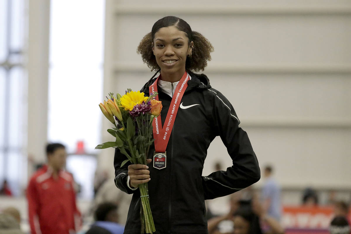 Vashti Cunningham poses for photographers after winning the women's high jump final at the USA ...
