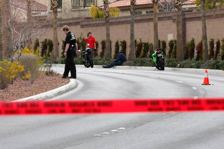 Police investigate a fatal motorcycle accident near the intersection of Tenaya Way and Robindal ...