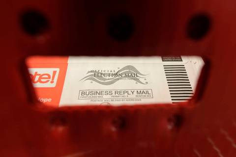 A box of ballots mailed in for the Washington state primary election are shown Tuesday, March 1 ...