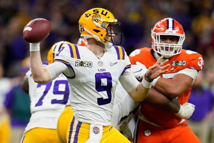 LSU quarterback Joe Burrow passes against Clemson during the first half of a NCAA College Footb ...