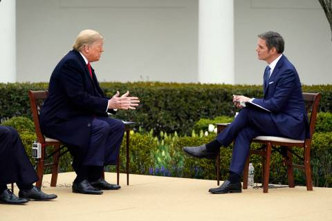 President Donald Trump speaks with Fox News Channel Anchor Bill Hemmer during a Fox News Channe ...