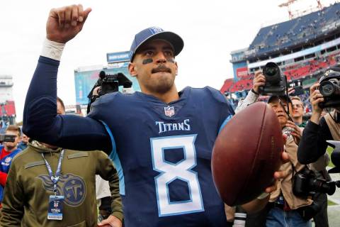 Tennessee Titans quarterback Marcus Mariota (8) leaves the field after the Titans beat the New ...