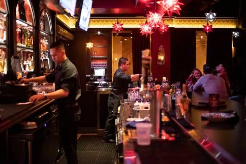 Christian Carino, center, mixes drinks at El Dorado Cantina in Tivoli Village on Tuesday, March ...
