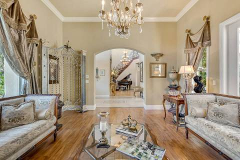 A parlor off the entry features hand-scraped cherry hardwood flooring. (Red Luxury Real Estate)