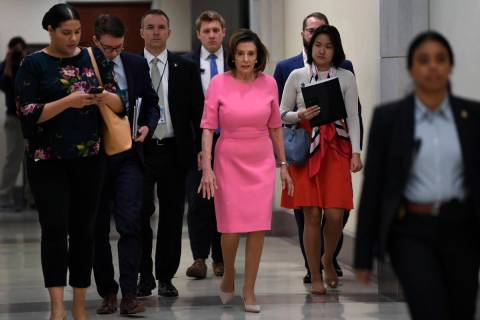 House Speaker Nancy Pelosi of Calif., heads to a news conference on Capitol Hill in Washington, ...