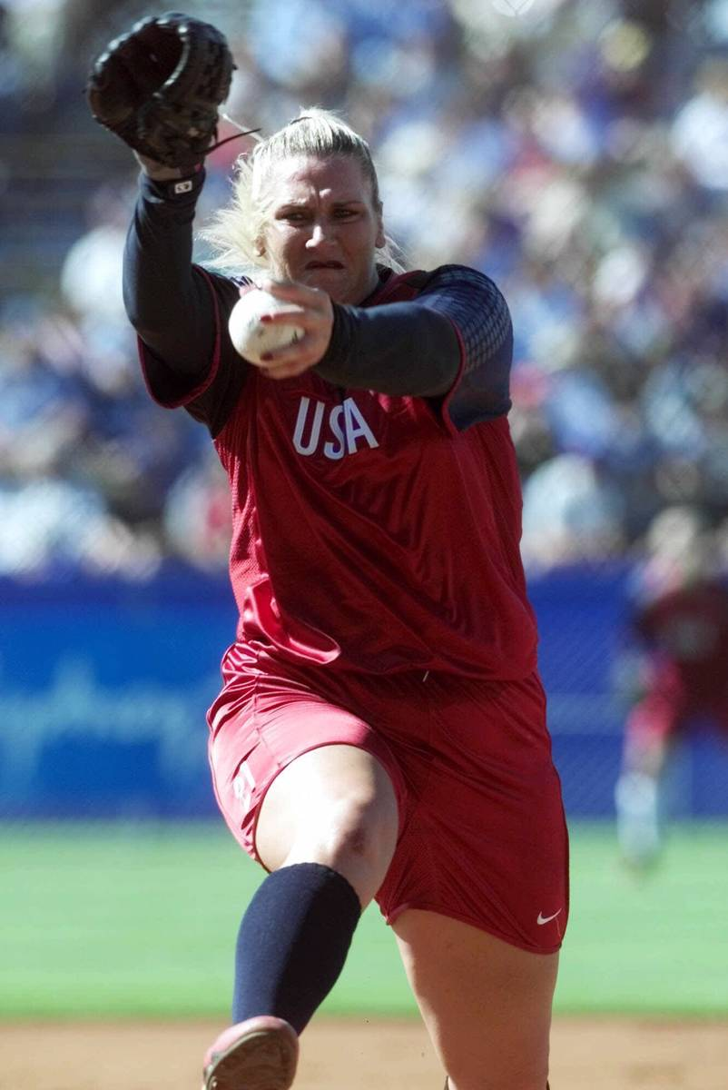 The United States pitcher Lori Harrigan hurls a pitch on her way to a no-hitter against Canada ...
