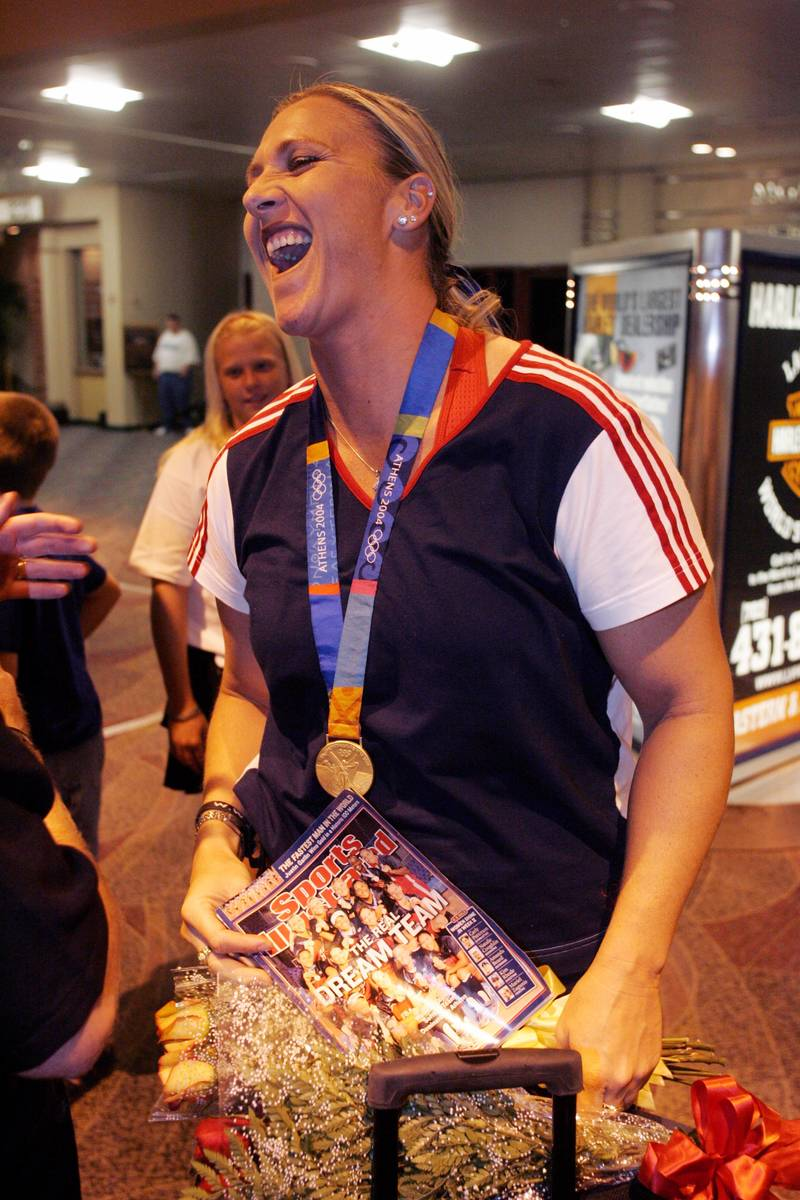 Now two time Olympic Gold medalist Lori Harrigan arrives at McCarran Airport Monday August 30, ...