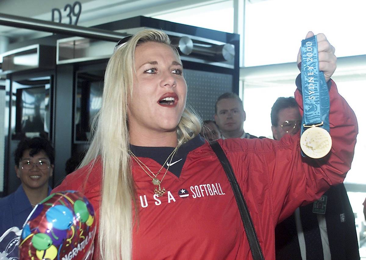 Former UNLV star softball pitcher Lori Harrigan shows off her gold medal from the Olympics. Rev ...