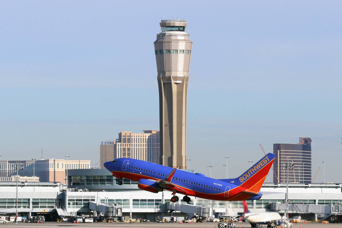 The air traffic control tower at Las Vegas' McCarran International Airport is seen as a Southwe ...