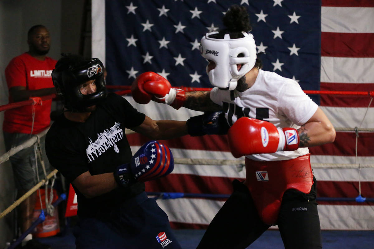 Rahim Gonzales, left, moves away from a punch against Bowe Van Dam during a sparring match at C ...