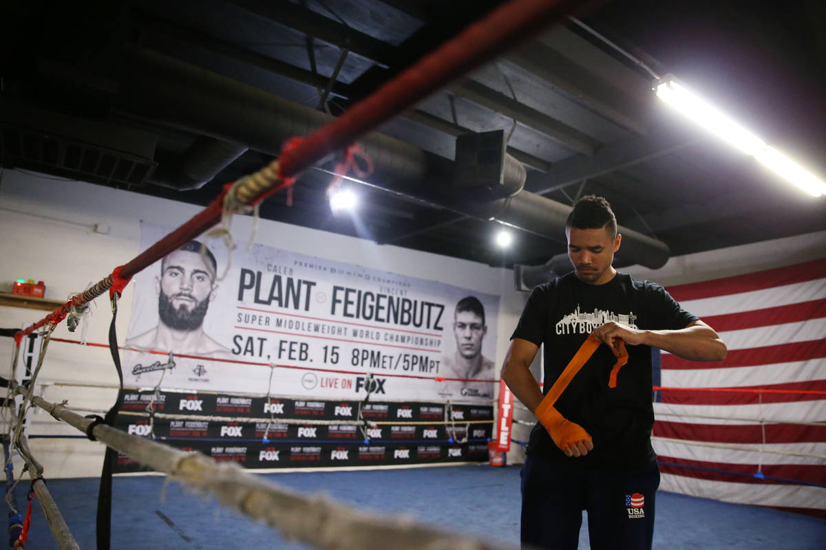 Rahim Gonzales wraps his hands for a workout at City Boxing Club in Las Vegas, Friday, Feb. 28, ...