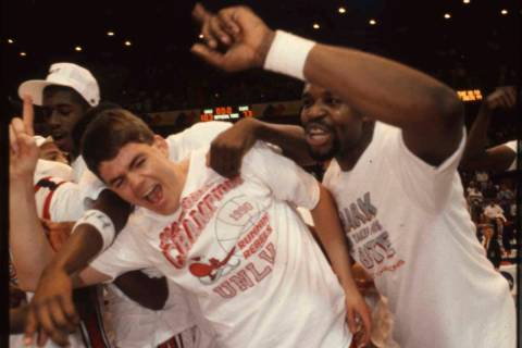 David Rice and Mosses Scurry celebrate after the victory in the NCAA National Championship bask ...