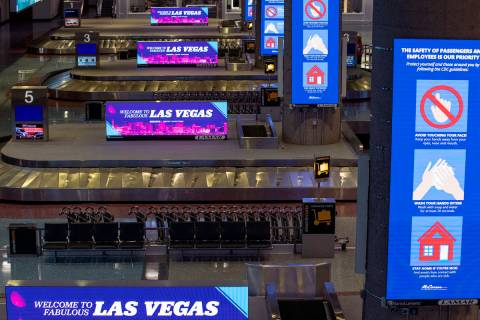 Baggage carousels sit unused at McCarran International Airport on Wednesday, April 1, 2020, in ...