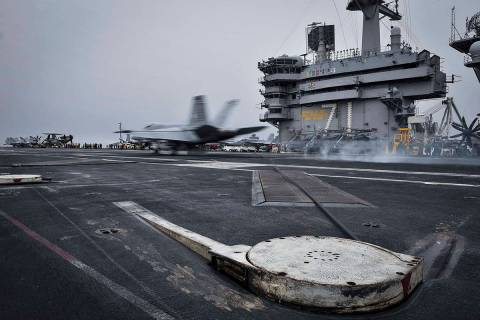 In this Wednesday, April 15, 2015 image released by U.S. Navy Media Content Services, an F/A-18 ...