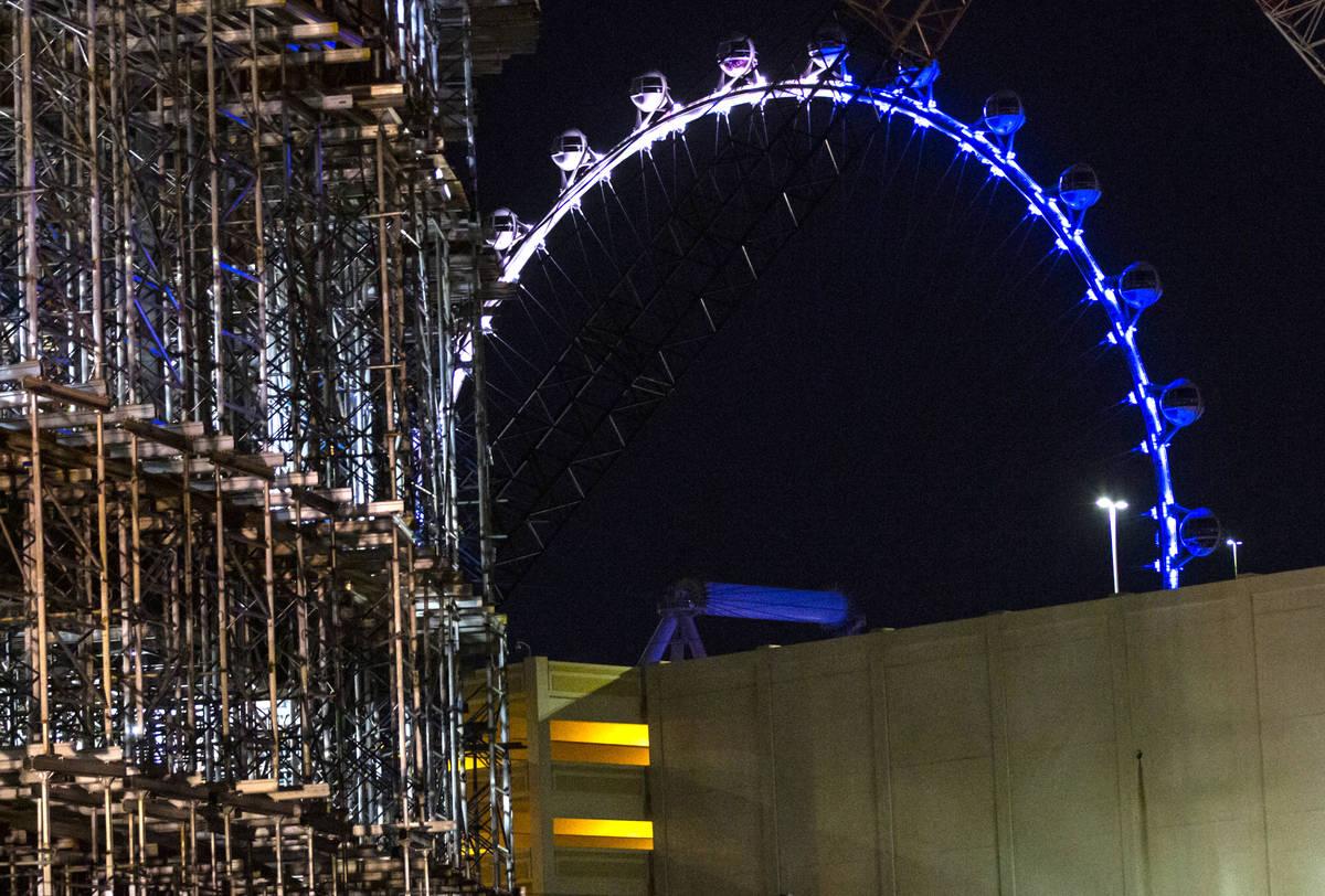 The High Roller is lit blue in memory of Nevada Highway Patrol Sgt. Benjamin Jenkins in Las Veg ...