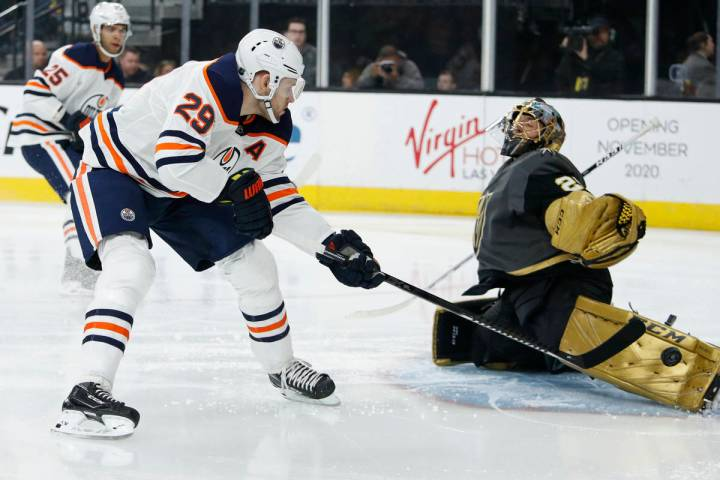 Edmonton Oilers center Leon Draisaitl (29) takes a shot on Vegas Golden Knights goaltender Marc ...