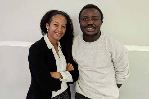 Christopher Njingu, right, an asylum seeker from Cameroon, with his attorney, Enedina Kassamani ...