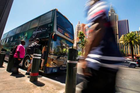 Passengers board an RTC bus north of the MGM Grand on the Strip on Tuesday, Aug. 13, 2019 in La ...