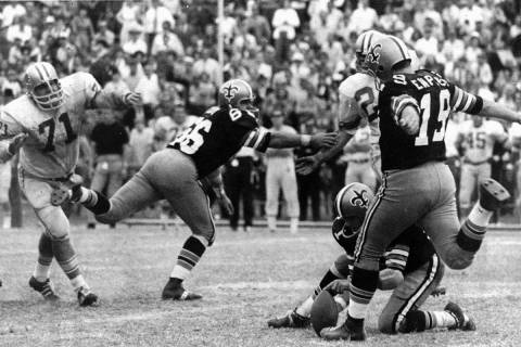 FILE - In this Nov. 8, 1970, file photo, New Orleans Saints' Tom Dempsey (19) moves up to kick ...