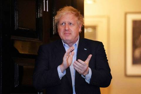 In this handout photo provided by 10 Downing Street, Britain's Prime Minister Boris Johnson cla ...