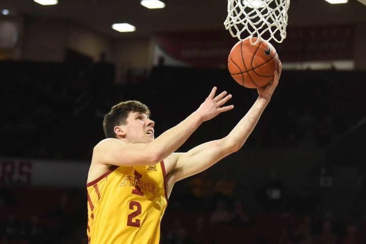 Iowa State guard Caleb Grill goes up for a shot during the first half of the team's NCAA colleg ...