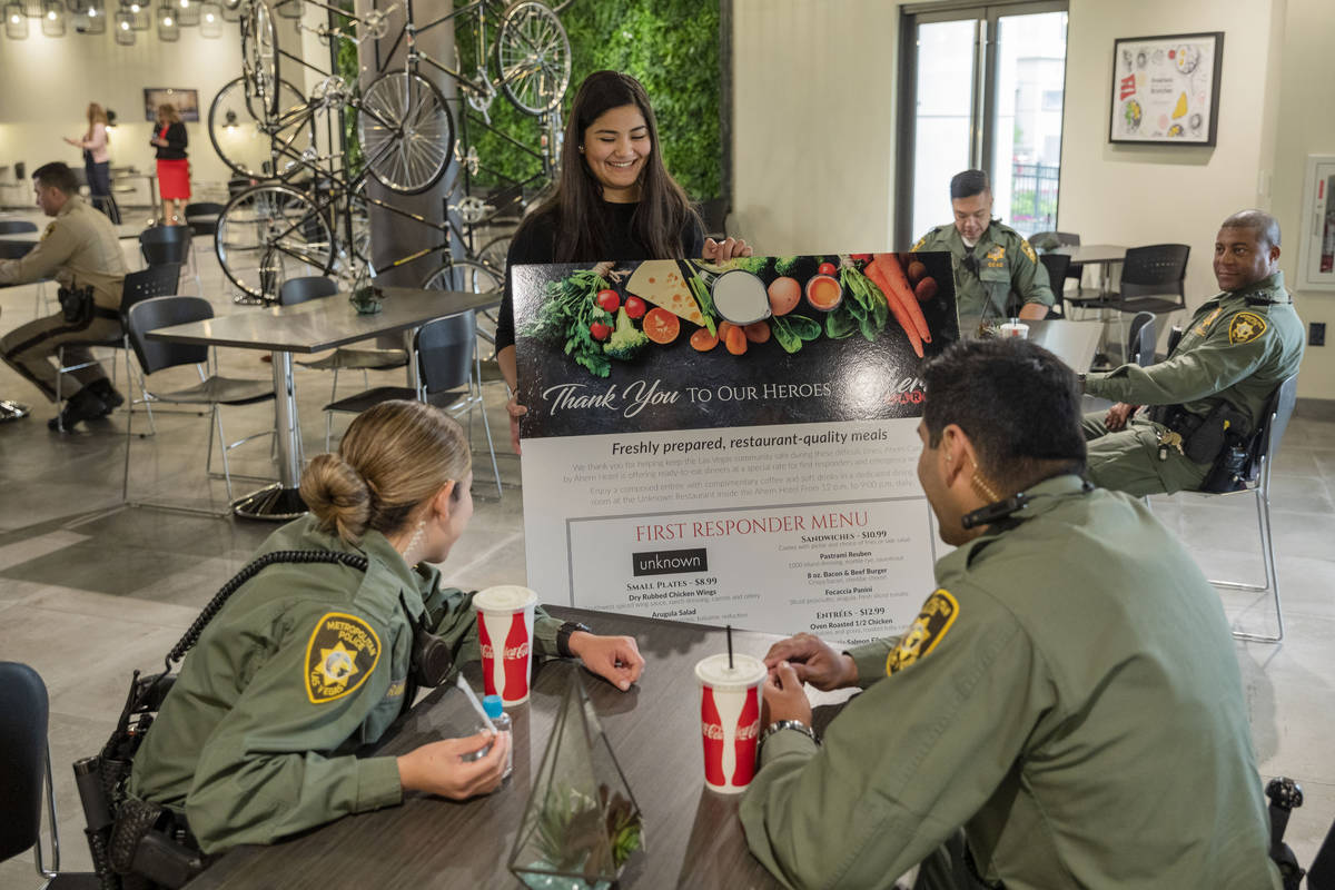 Officers of the Las Vegas Metropolitan Police Department order meals at Unknown restaurant at A ...