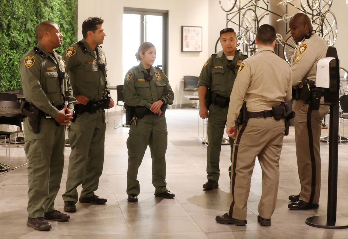 Las Vegas Metropolitan Police Department officers arrive to receive a meal provided for first r ...