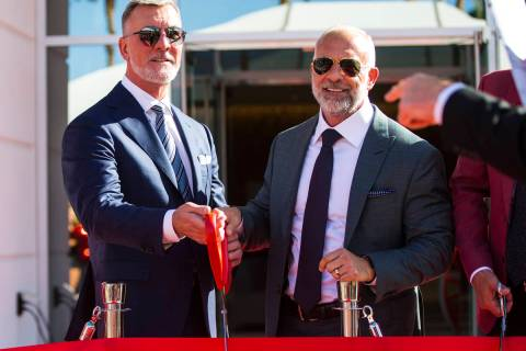 Frank Fertitta III, left, and Lorenzo Fertitta, prepare to cut the ribbon for the Fertitta Foot ...