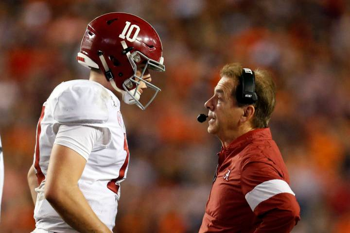 Alabama quarterback Mac Jones (10) talks with head coach Nick Saban during the second half of a ...