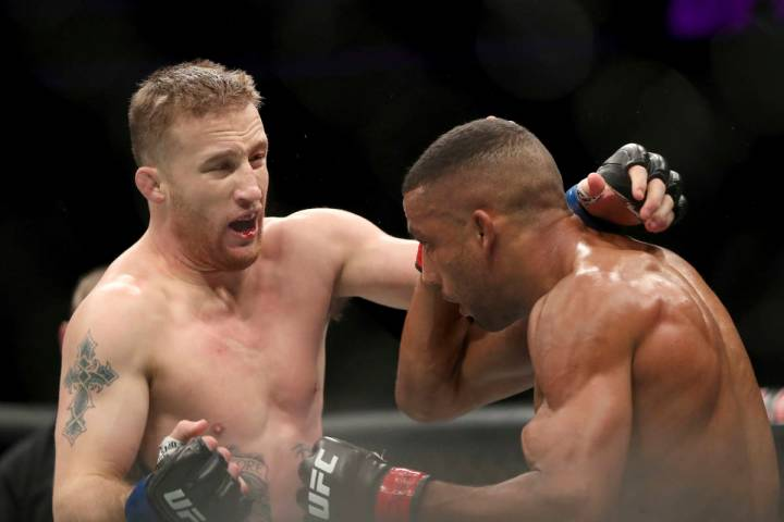 Justin Gaethje, left, exchanges with Edson Barboza during their mixed martial arts bout at UFC ...
