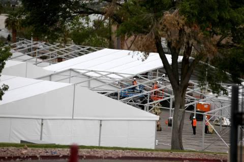 Workers construct the Cashman Isolation-Quarantine Complex at Cashman Center in Las Vegas Monda ...