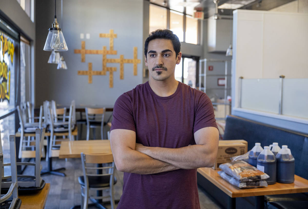 Hamed Emamzadeh, owner of Griddlecakes on S Fort Apache Road, is photographed in his restaurant ...