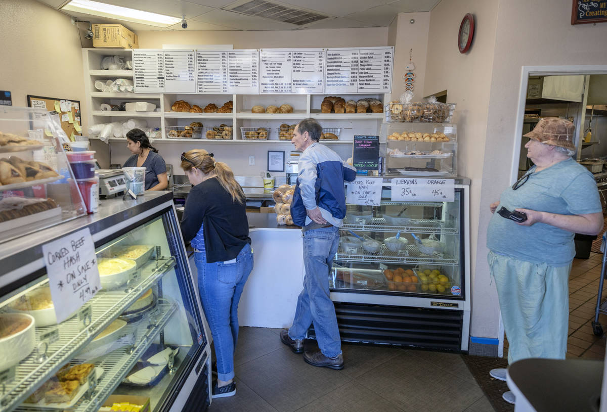 Customers of Weiss Deli and Bakery wait to place a takeout order, in Las Vegas on Friday, April ...